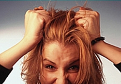 Woman pulling hair out