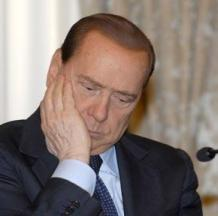 Silvio Berlusconi's controversial hairline appears intact